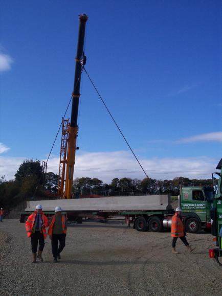 Crane offloading beams - In the photograph Roy Ashforth, Gary Liddell, Tim Lester.