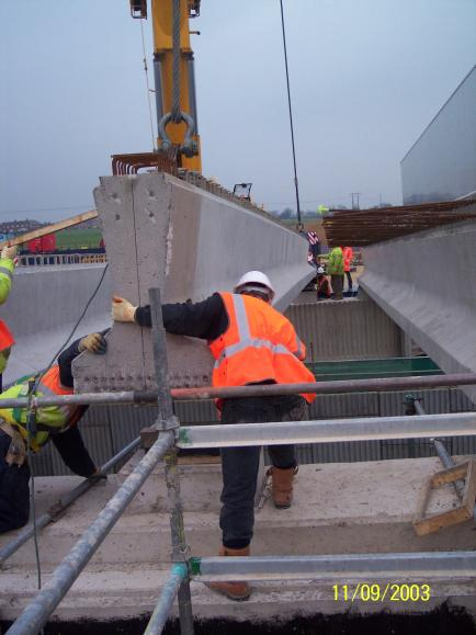 Final beam being installed - Bob Meadows landing the beam with John Masterson on the North abutment