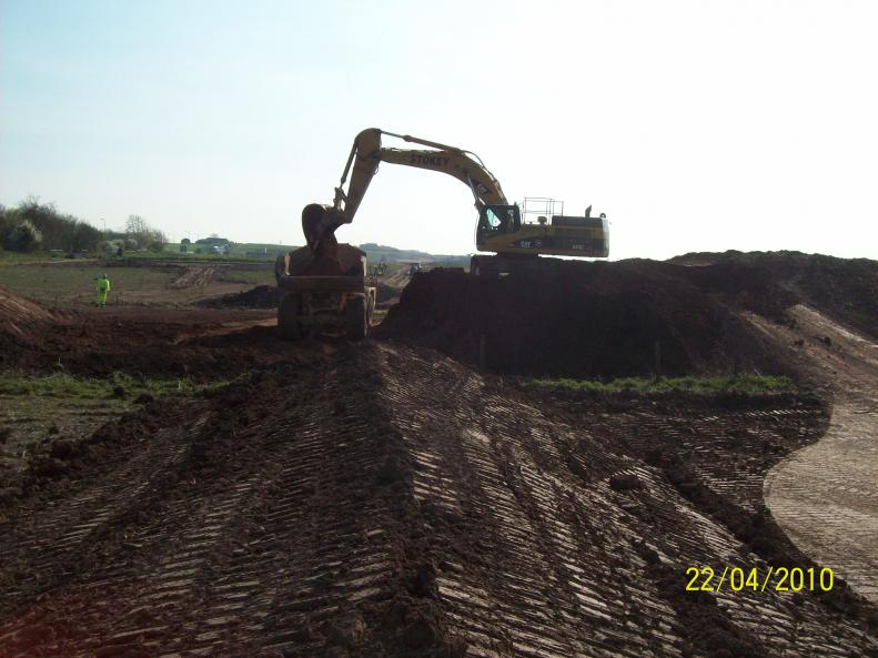 Old embankment being removed - trial.