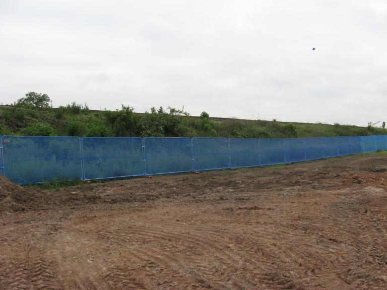 South side - temporary fence installed