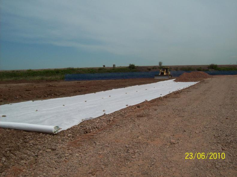 Geotextile and stone being placed in the site compound build area