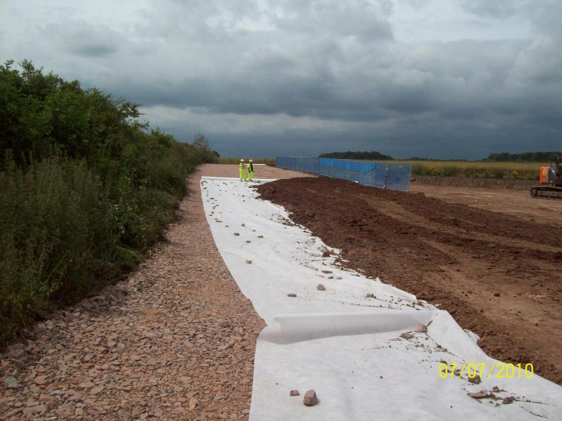 South Side -stone layer installed with geotextile and fill material being placed Class 2