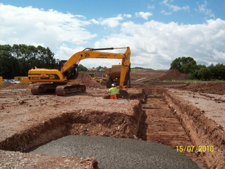 Temporary Casting beds being excavated by John Jones with MRC place the concrete.