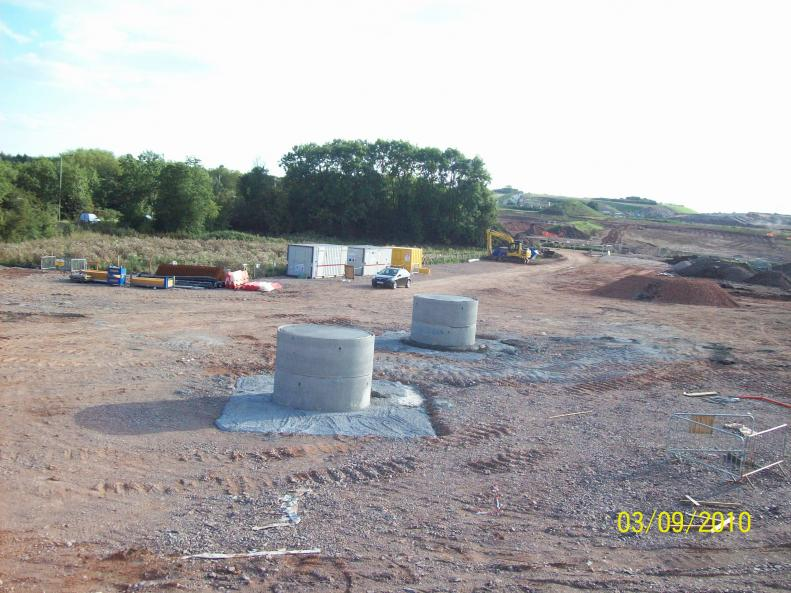 Central supports concreted manholes temporary works.