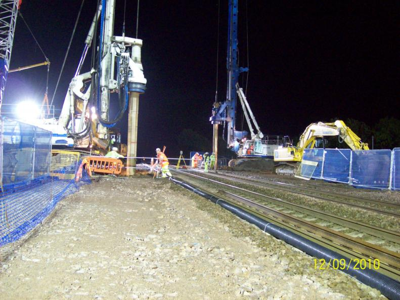 Piling rigs carrying out the pre- bore at track level.