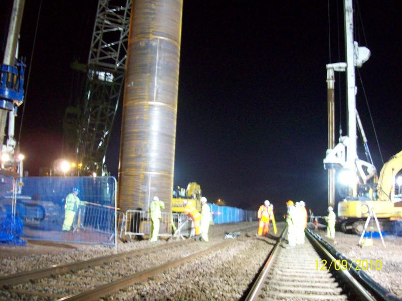 Pile casings being lifted into the pre-bore.