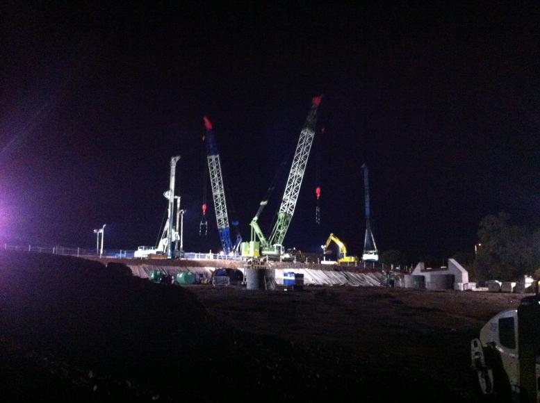 View of the piling at night from the compound