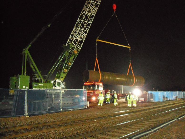 2nd Possession Crane lifting and unloading steel casing.