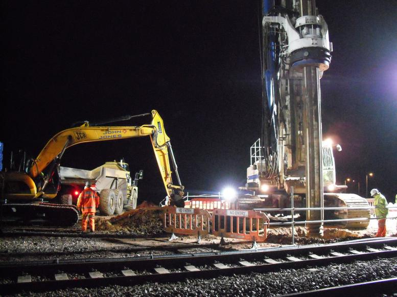 Piling rig drilling the prebore - John Johns cleaning up the spoil from the bore.