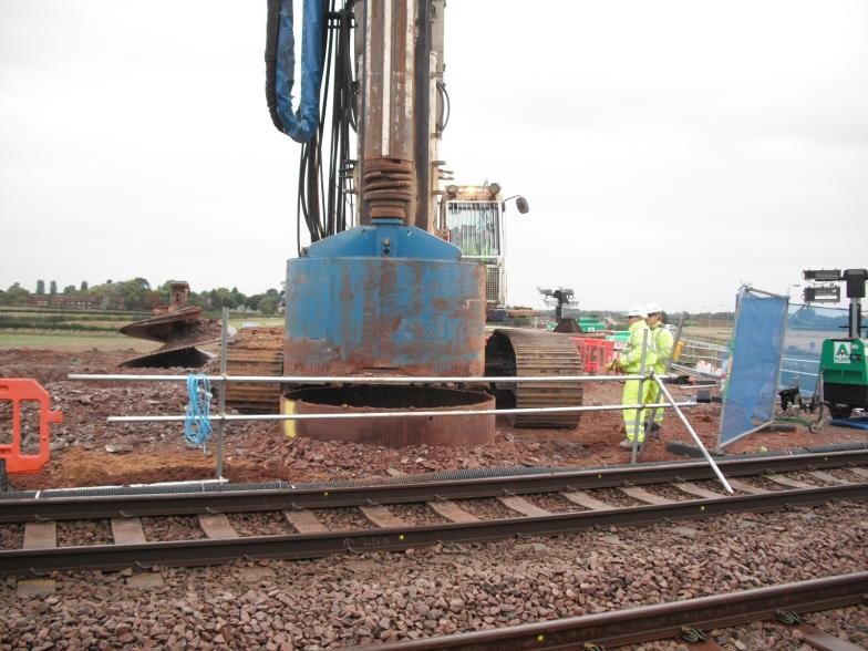 Pile cleaning head attached to the piling rig.
