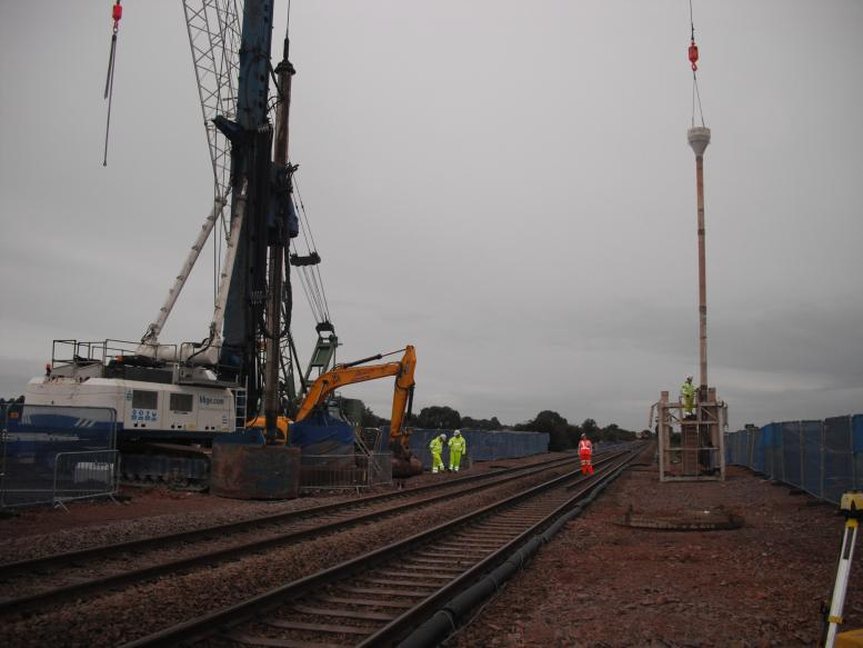 Tremie pipe being connected up lifted into place with the crawler crane