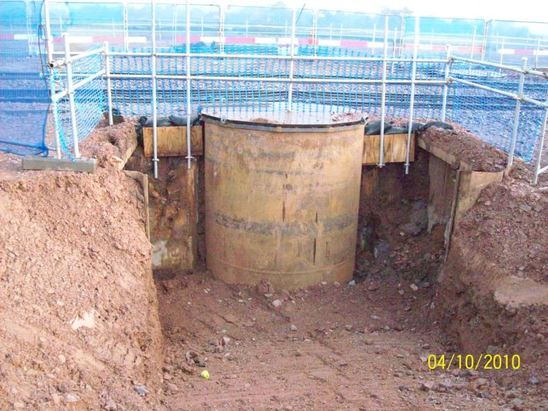 Steel casings  exposed with the front face manhole rings removed.