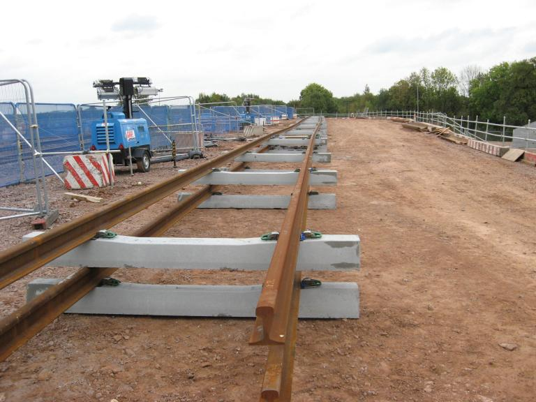 Rails being set up on the South Piling platform with rails being welded to lengths.