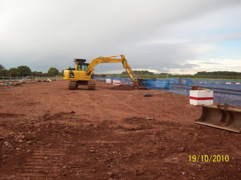 John Jones digging out the southern piling casing on the platform.