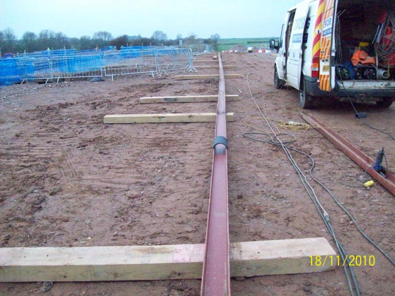 Steel channel being installed to carry cables in Phase II