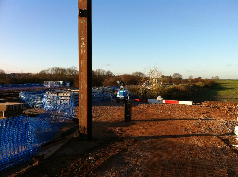 Concrete sleepers are stockpiled ready for Christmas + Cable stay tower for the cable bridge.