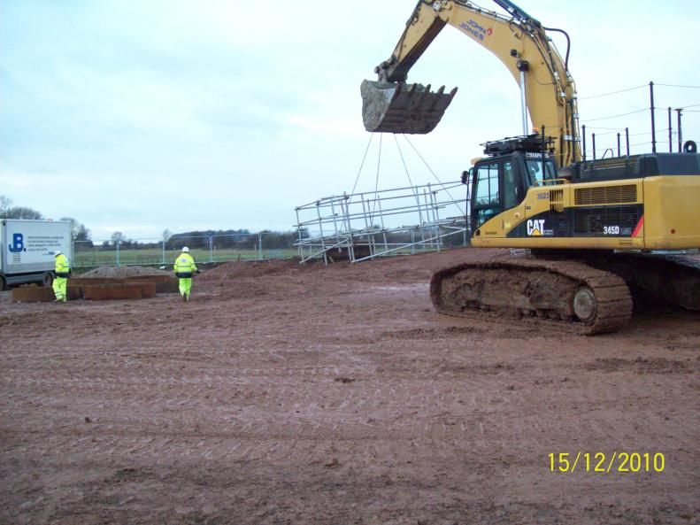 Excavator lifting and moving scaffold access frames.