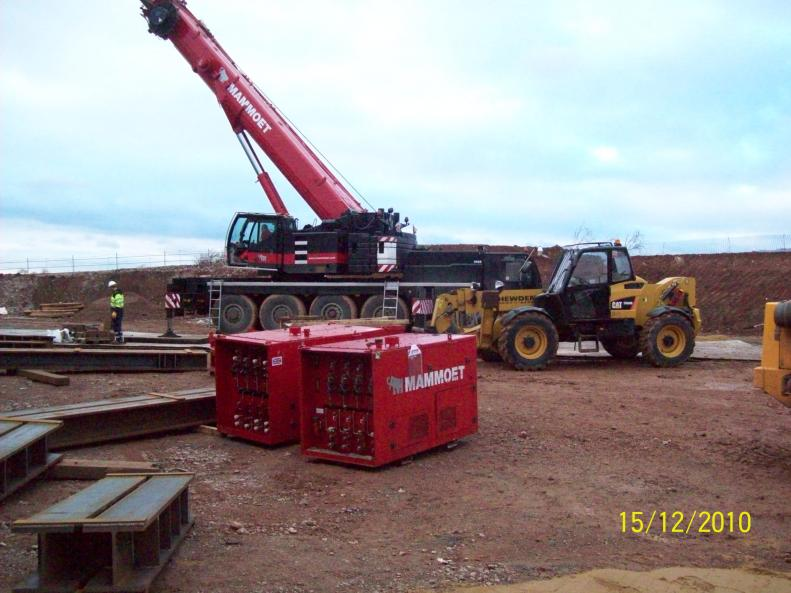 Mammoet crane on site - beams and power packs being laid out on site.
