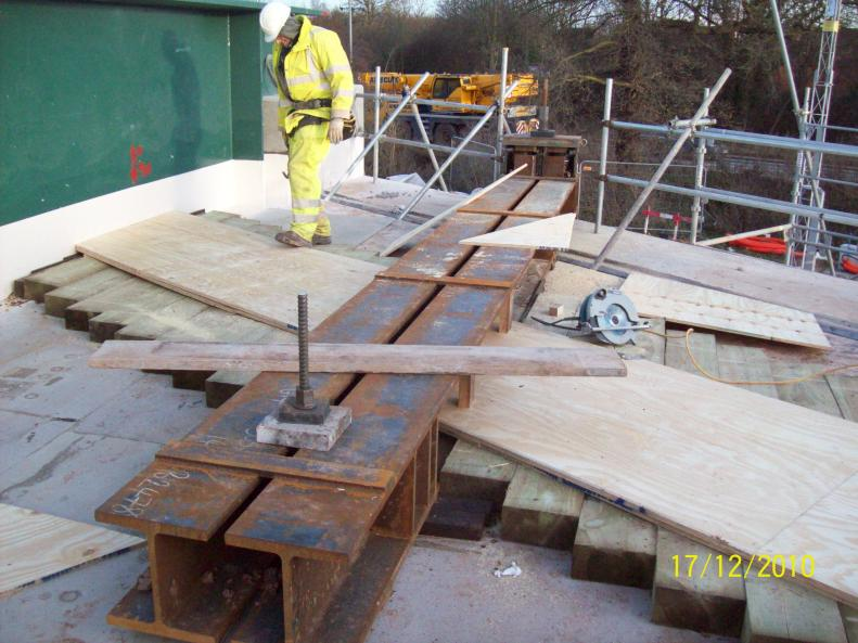 Sleepers and plywood wedge fitted between the carrier beams.