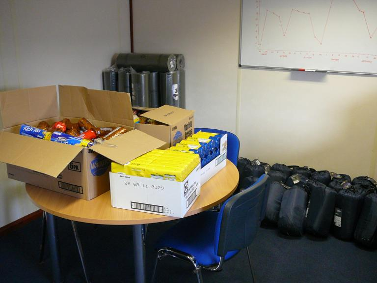 Roll mats, sleeping backs and food - extra supplies just encase the weather stops people leaving site.