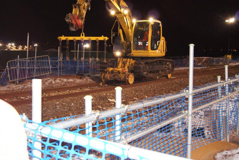 RRV fitted out with sleeper lifting attachment - sleepers for reuse were stockpiled out of the dig area for later reuse.