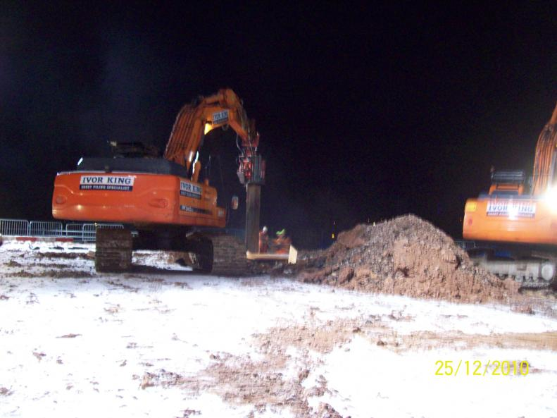 Ivor King Movax rig extracting sheet piles form around the piles.