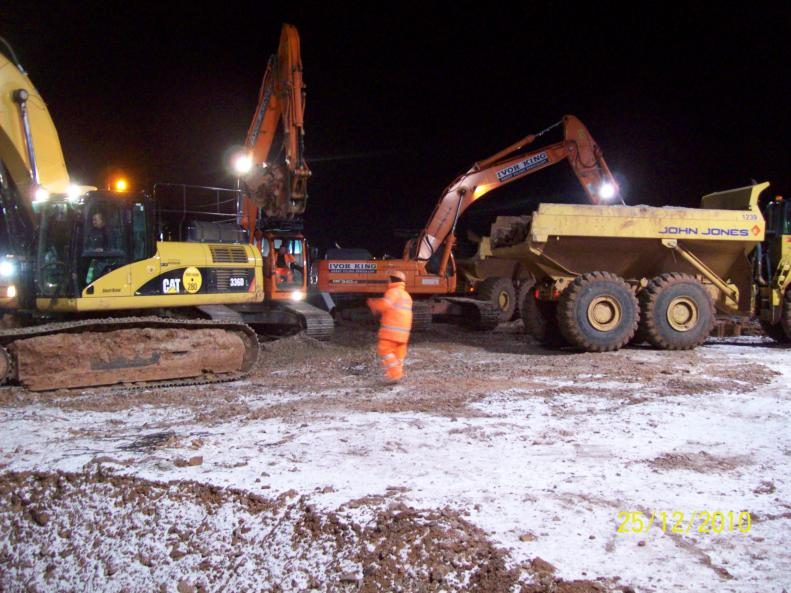 John Jones and Ivor King working together to bulk dig and remove sheet piles.