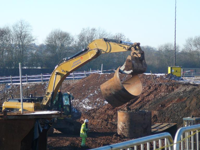 Top section of pile casing being removed.