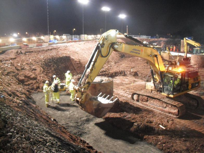 Excavator being used to the mass fill concrete.