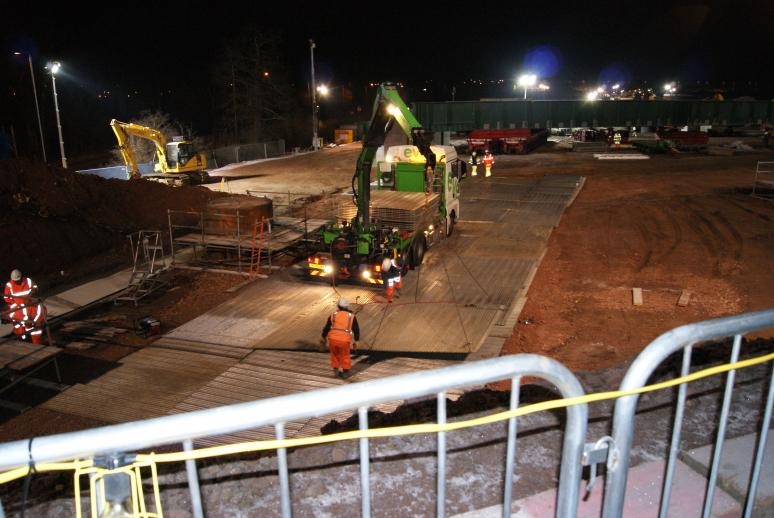 Eve trackway installing track panels to the East drive path.