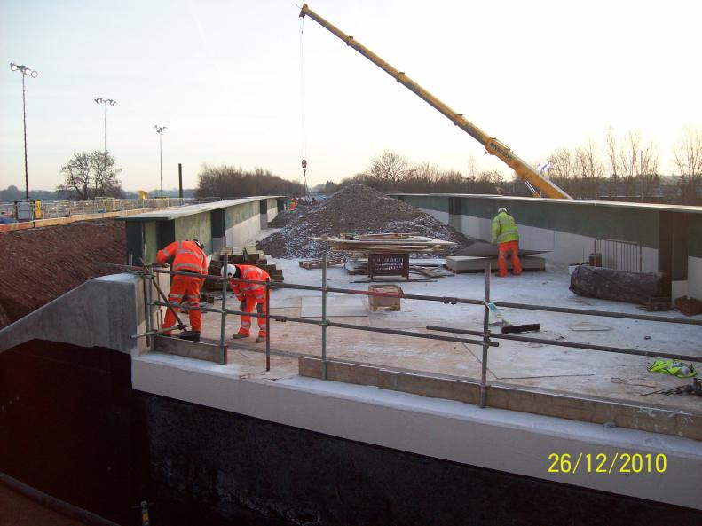 Waterseal working on the deck to fit out the bridge joints. Ainscough lifting out the temporary works.