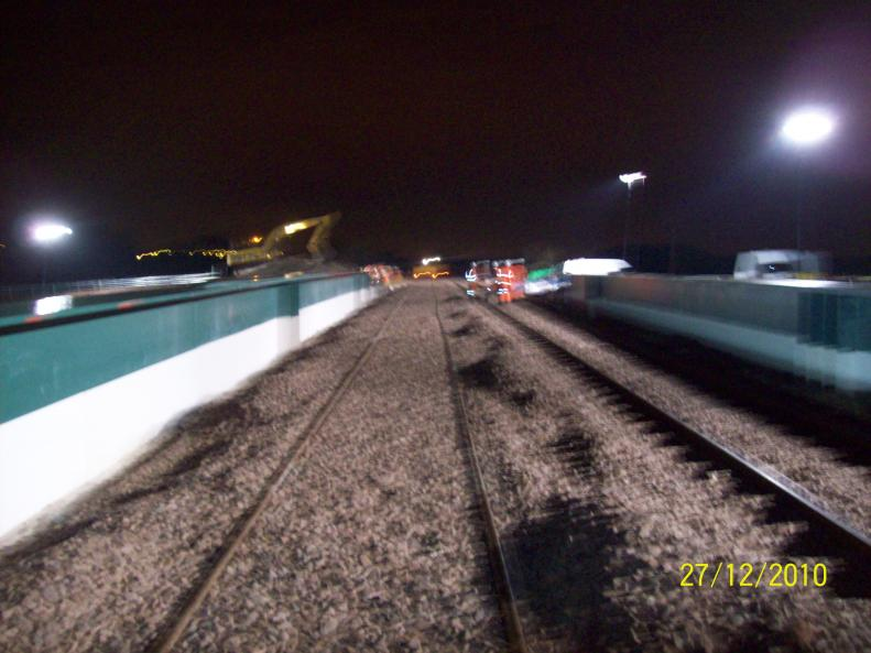 Both Tracks top ballasted and getting ready for the tamper.