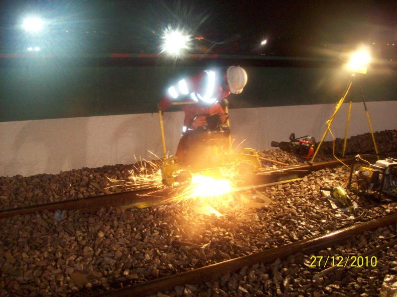 Rail Grinder running over the welds cleaning them up.