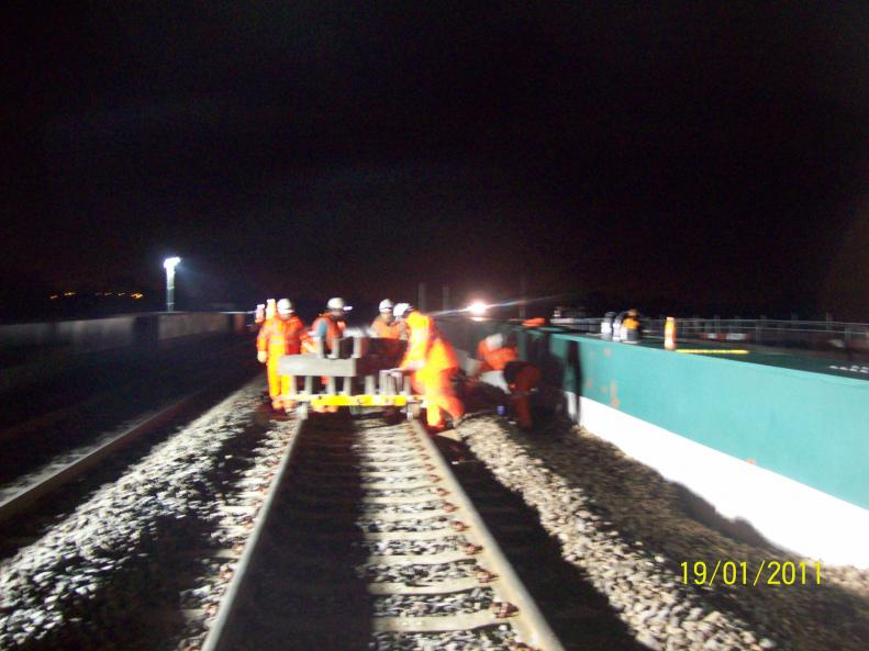 Concrete trough route being installed using trolley.