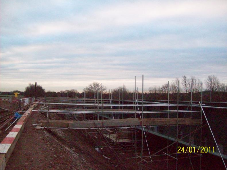Scaffold Access ways used to move the cables from the embankment onto the bridge.
