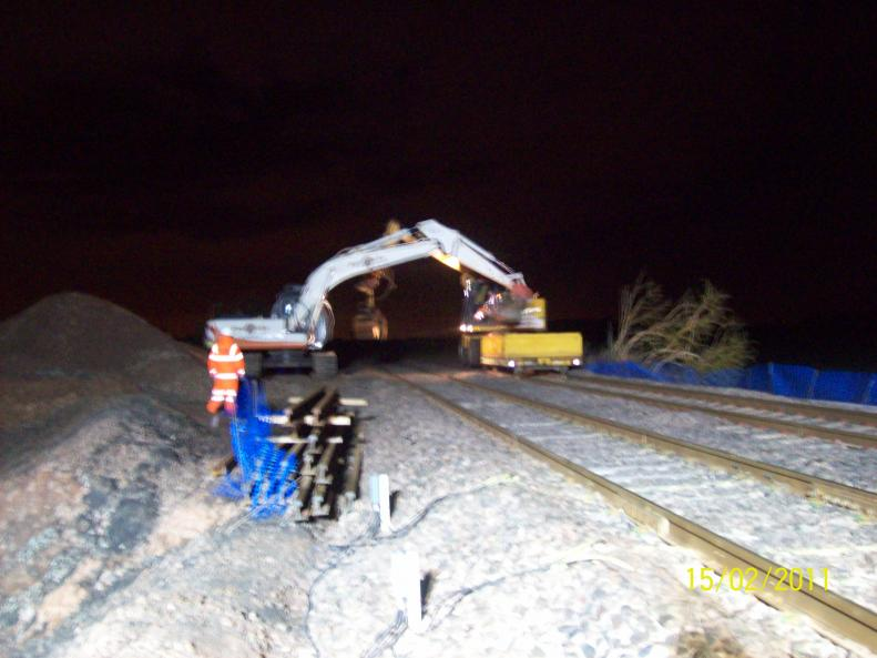 Excavator loading up the RRV and ballast box