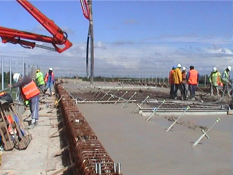 Concrete being placed on the deck form the two ends in