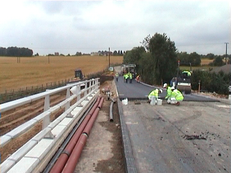 Black top being placed on the approaches