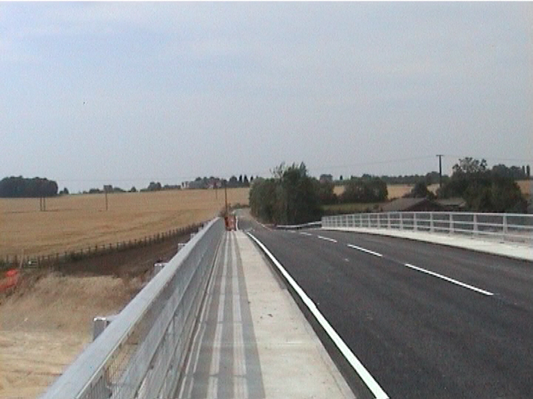 White lines on the bridge. The deck open to traffic.