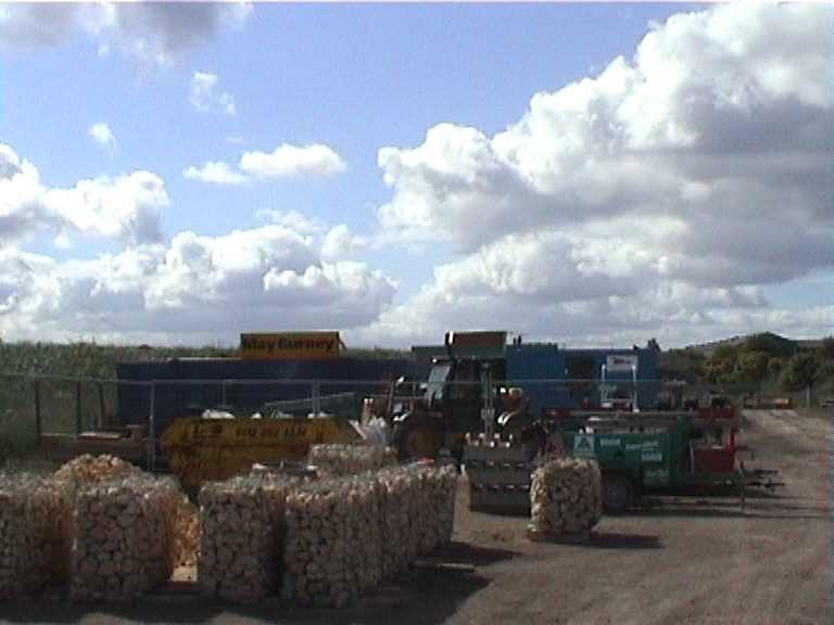 Gabion baskets being made up ready for lifting into place in the possession.