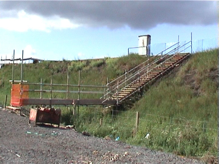 SYS Ltd installing an access up to the embankment as track access.