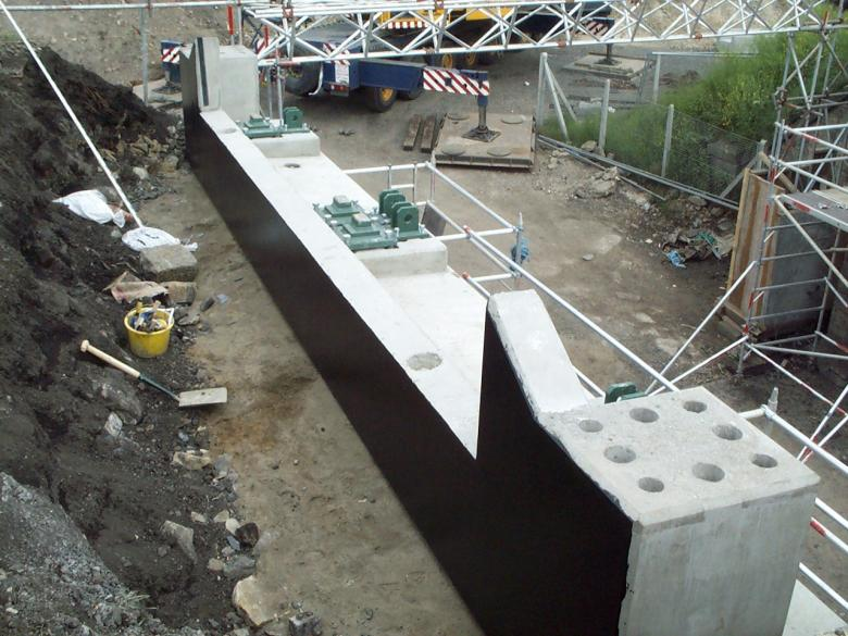 Bridge Impost unit lifted in and set on the sand cement screed.