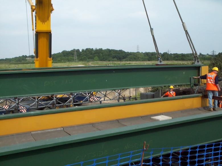 2nd bridge deck being lifted into place - David Millar on the Deck.