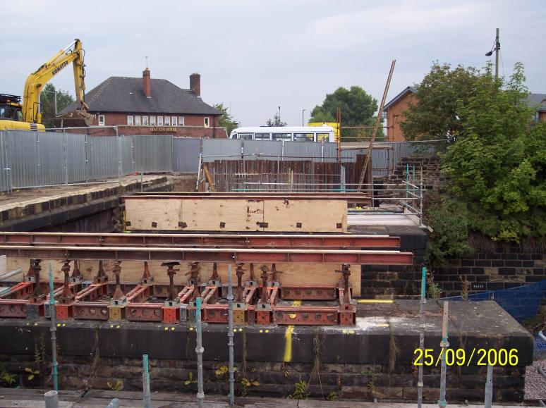 Temporary works installed and parapet wall removed in possession.