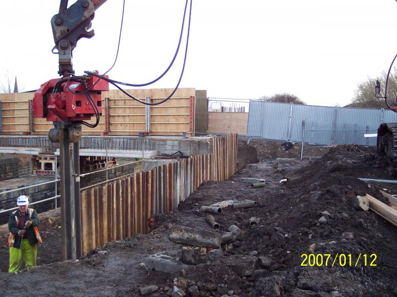 Phase II sheet piles being installed on the South Abutment.