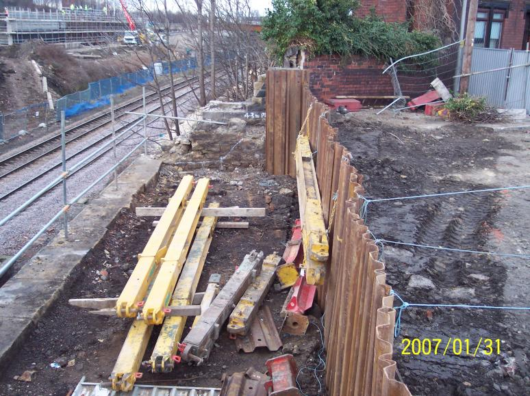 Phase II - North abtment sheet piles installed with frames delivered to site.