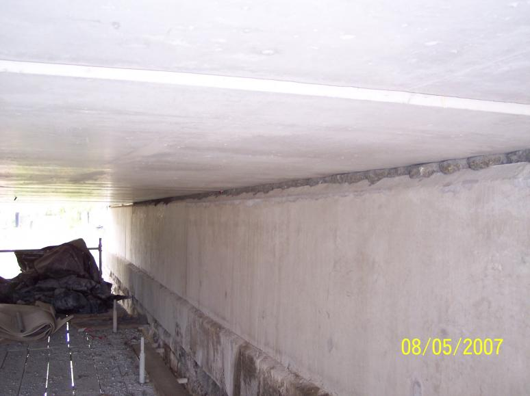 Units set onto grout on the abutments - the shims set the units to level.