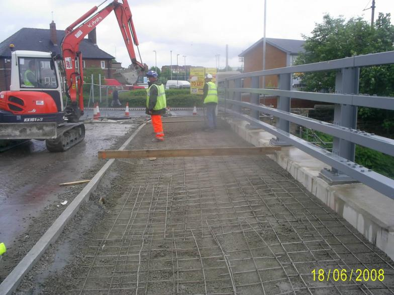 Concrete mesh placed over the ducts on the bridge - being topped up with concrete.