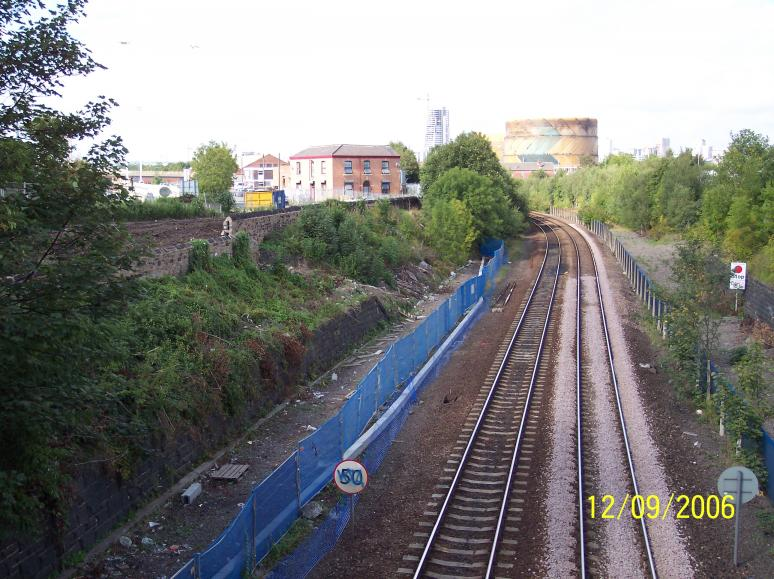 Cable trough and fence installed at track level.