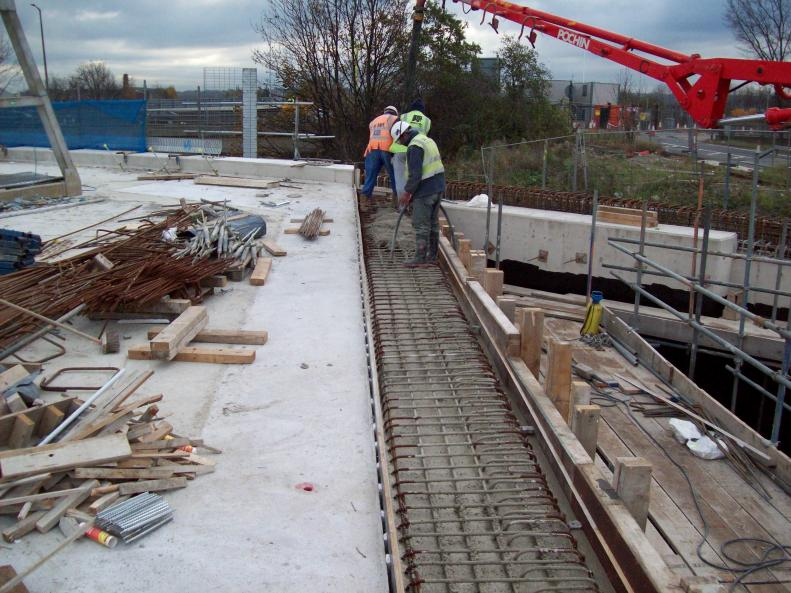 Screen wall capping section being concrete to create the expansion joint.